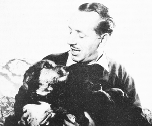"""Bernard Cuff, with mother and puppies. This photograph by courtesy of the """"Daily Express"""" appeared in November 1959, and made us quite a number of friends."""
