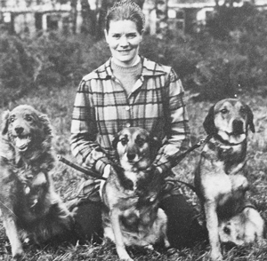 Connie who helped us on a voluntary basis from 1962, prior to joining us permanently a few years later, pictured with three three-legged dogs.