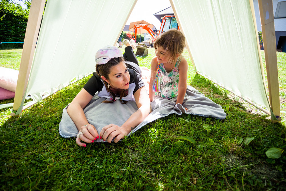 ©TomWoollard_OBI_woman-and-young-girl-lying-on-grass-in-shade-of-summer-garden-tent.jpg