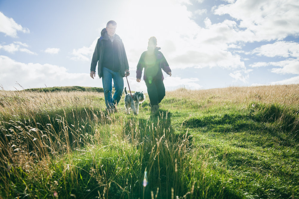 ©TomWoollard_Walkers_Are_Welcome-editorial-lifestyle-couple-hikers-walking-dog-sunny-day-countryside.jpg