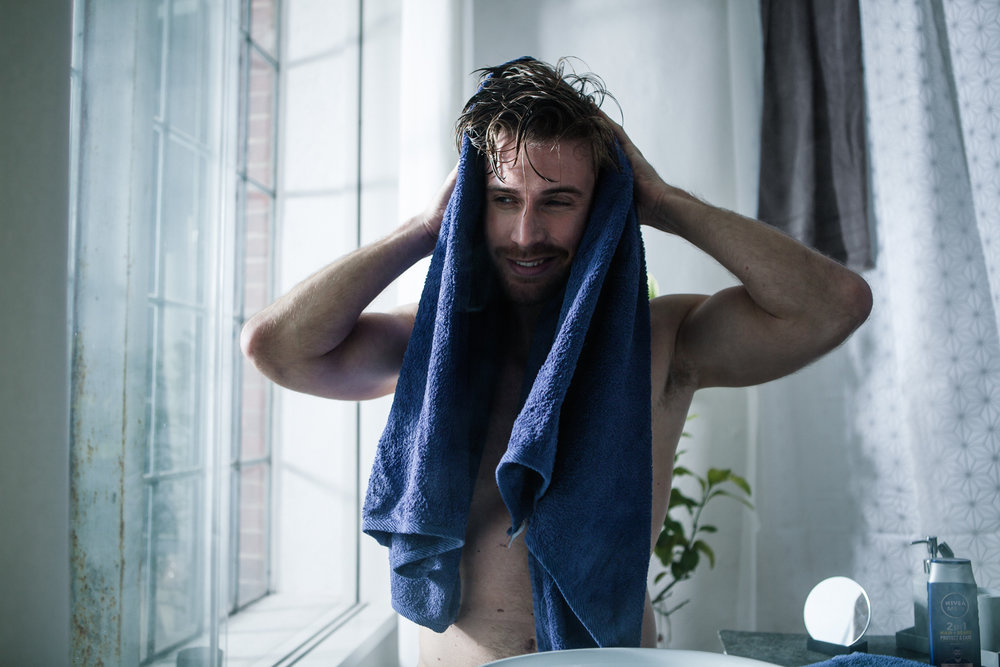 ©TomWoollard_NiveaMen_advertising-lifestyle-handsome-fit-man-with-beard-drying-hair-towel-in-bathroom.jpg