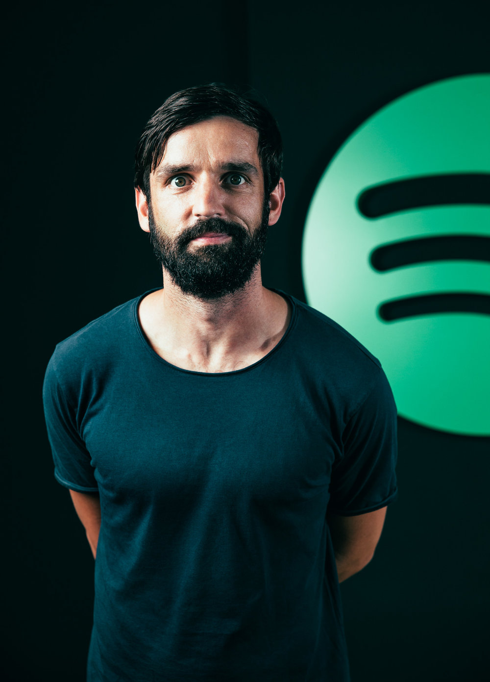 ©TomWoollard_Spotify_Berlin-Marcel-Grobe-editorial-music-portrait-with-Spotify-logo-in-background.jpg