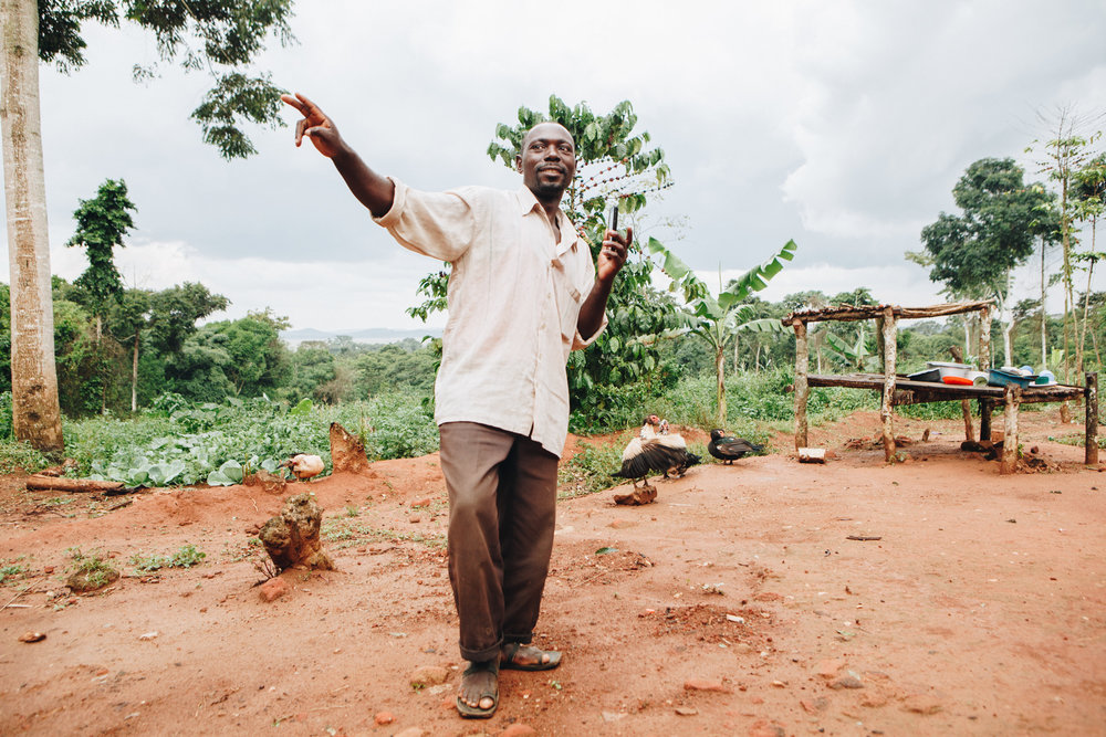 ©TomWoollard_Yunus-Social-Business_Uganda-editorial-portrait-african-man-dancing-on-pineapple-plantation-farm.jpg