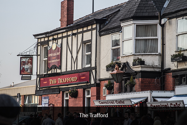 THE TRAFFFORD |  +44 161 848 0736  The Trafford Pub will give you a true local experience. The pub is a short 3-minute walk from Old Trafford, making it convenient for fans to stop here to have a pint before heading to the game.   Address:  699 Chester Road, Manchester M16 0GW