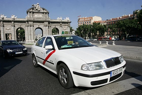 TAXI  Good option during the night time when the metro doesn't run. Flat fare from or to the airport is €30.Official Madrid Spain transport taxis are white with a red stripe.