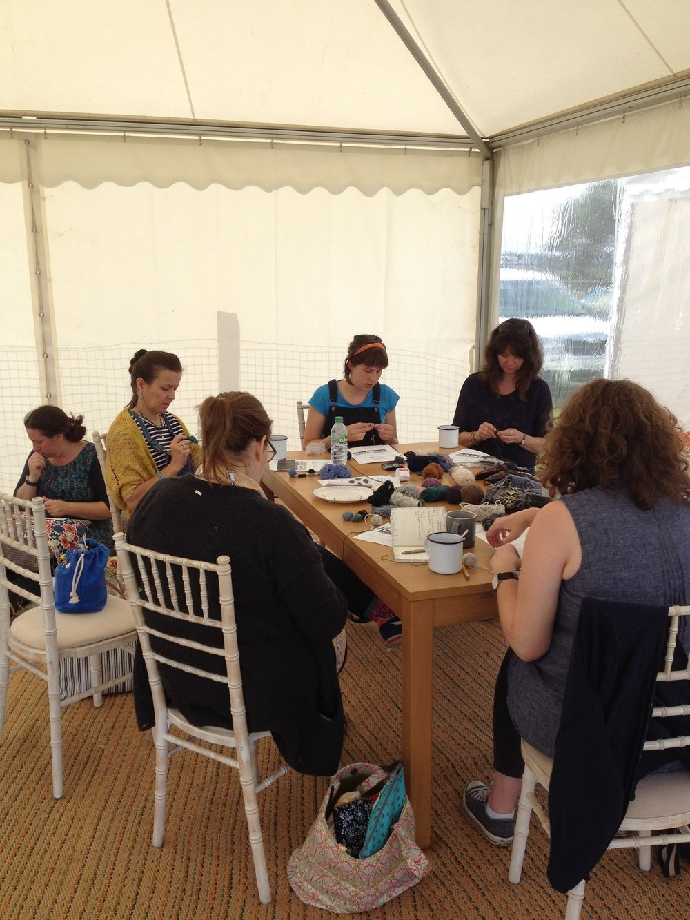 Teaching Fair Isle knitting inside the marquee