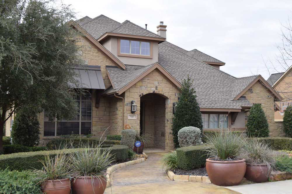 new-roof-stone-house-texas-traditions.jpg