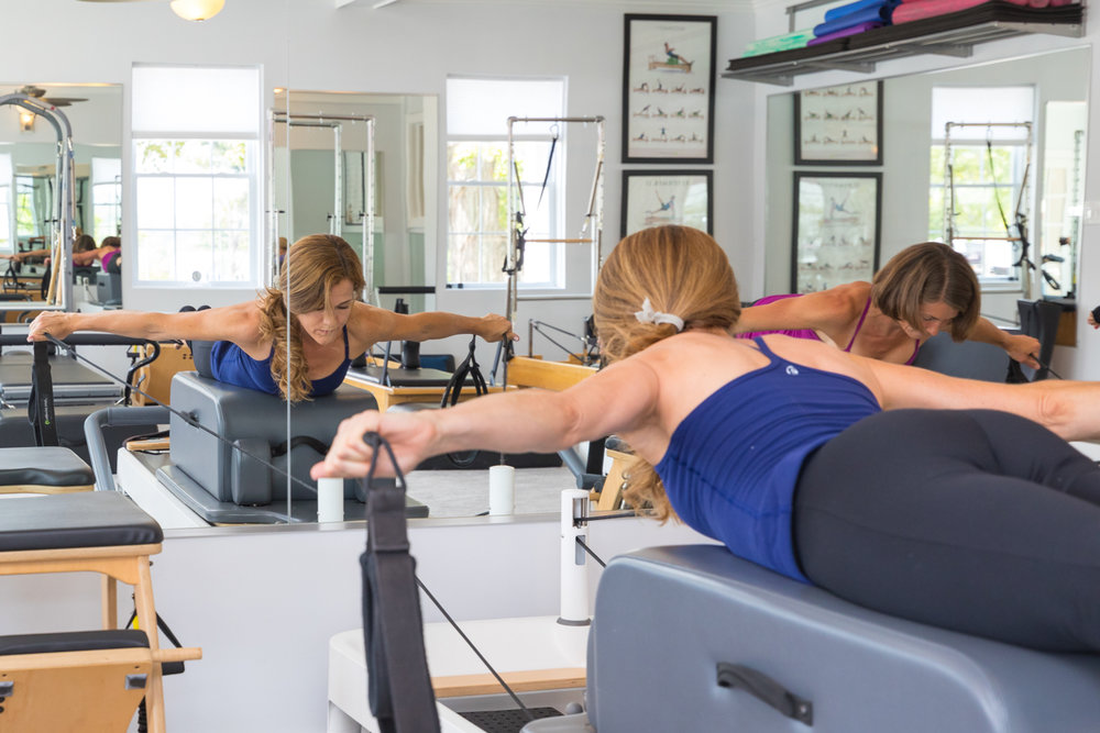 Invigorating - The Pilates Reformer is a versatile and completely unparalleled piece of equipment that provides resistance and support for exercises involving the entire body.  This comprehensive, alignment based workout targets all major muscle groups from a stable core and provides feedback to clients for superior results.  Reformer work is designed to accommodate everyone and is ideal for clients who seek deep core stability, balanced body strength and flexibility.  Our Reformer studio is equipped with Pilates Chairs, Barrels, and Towers as well, and students are taught exercises on all pieces of equipment in private, duet, trio and quad semi- private sessions.  Group classes in Reformer  and JumpBoard Reformer are also available.  for sign up online.  For placement recommendations, students are asked to call or e-mail the studio or speak to one of our Pilates instructors for guidance.