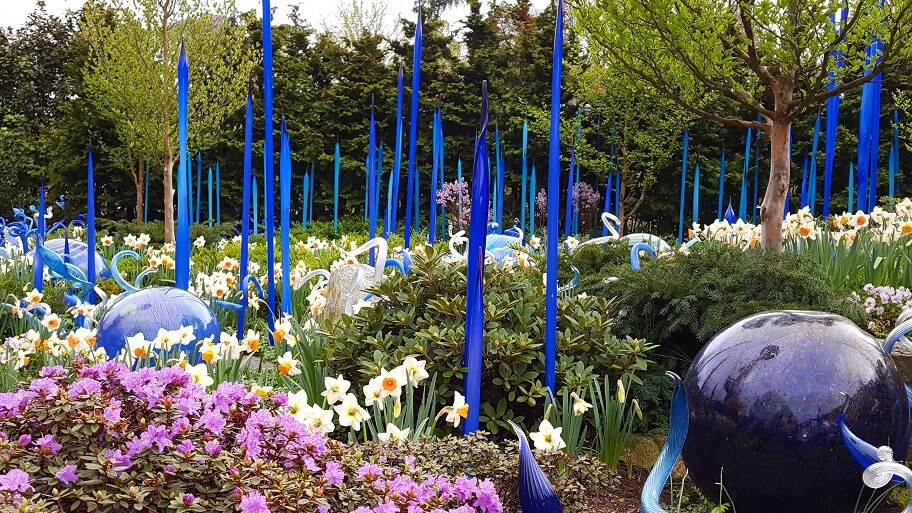 Chihuly-Garden-Seattle-flowers-plus-blue-glass-spikes-photo-by-Sheila-Scarborough-2.jpg