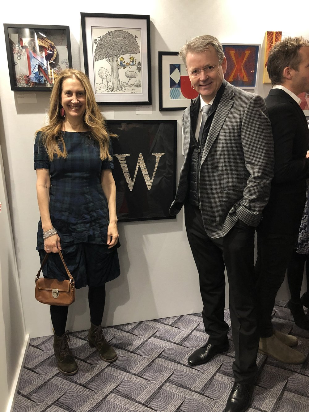 Mike and I at our kids' school auction. One of the auction items was to ask 26 artists to create a letter from the alphabet. Of course I chose the W! Made out of our wallcovering, Metaphor!  It brought it close to $800! Woohoo!