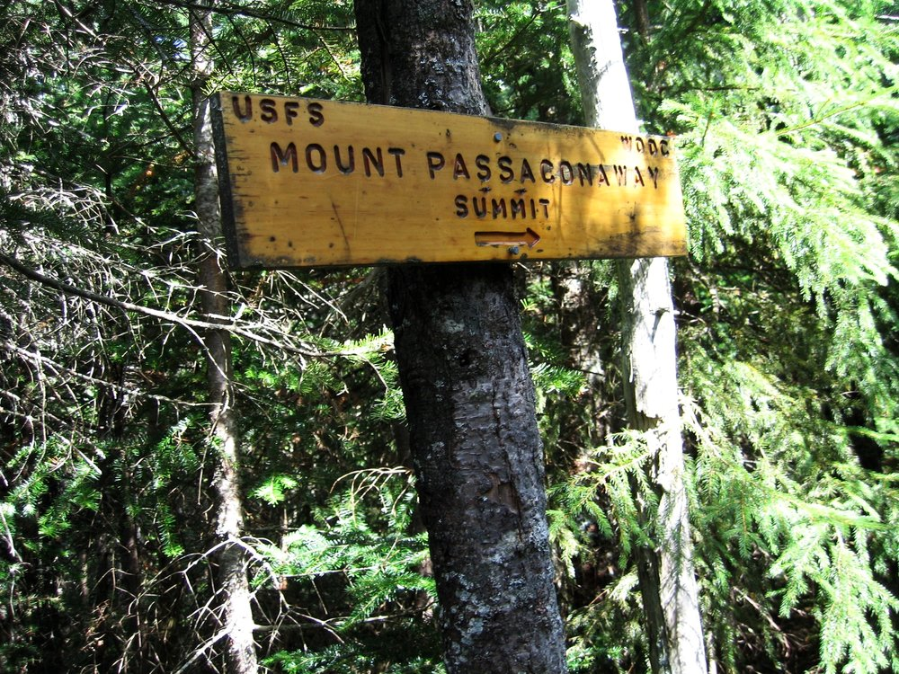 Sign marking the approach to the summit