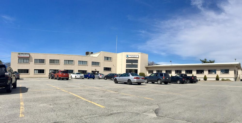 Front of building with ample parking