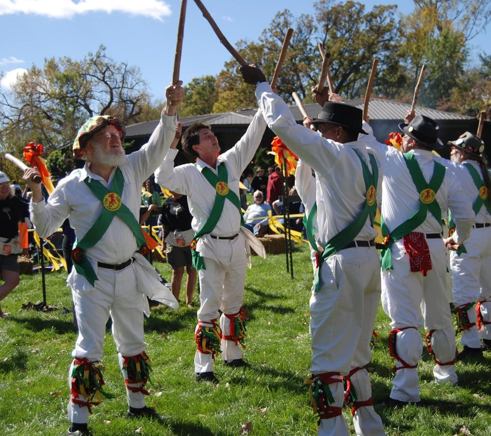 morris dancers salute in the stomp ring.jpg