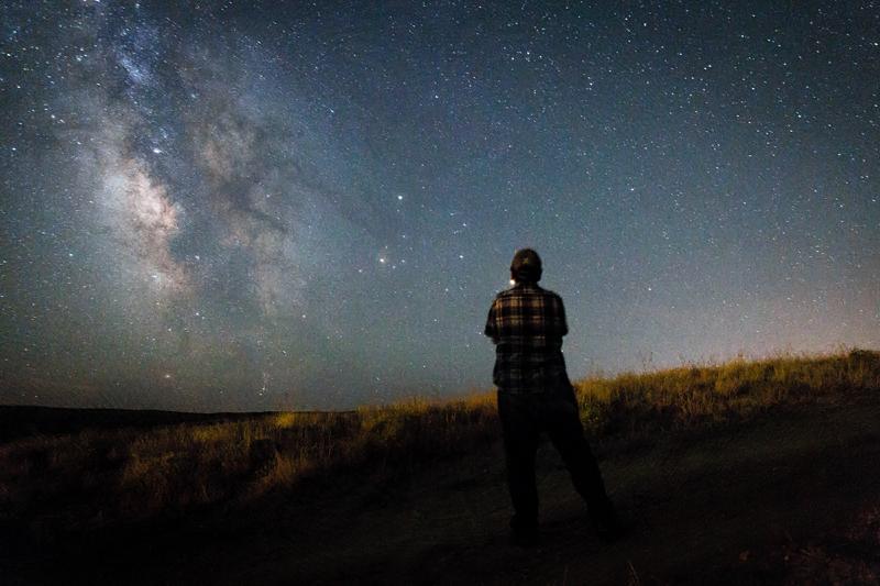 John is seen looking at the Milky Way Galaxy in Western Wyoming.