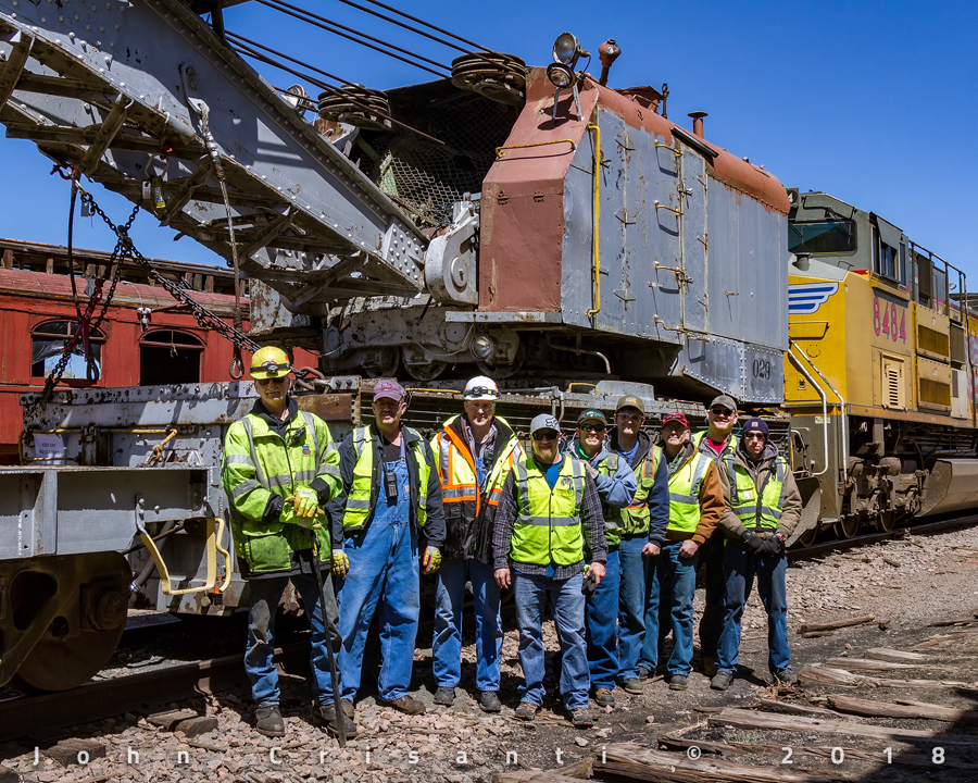 Group photo of the crew that made this move possible. Pictured from left to right:  Ted Schulte, Brad Eggeman, Ed Dickens, Unknown (Engineer), Jimmy Thompson, Nick Valdez, Ken Valdez, Unknown (Conductor), Unknown (Brakeman).