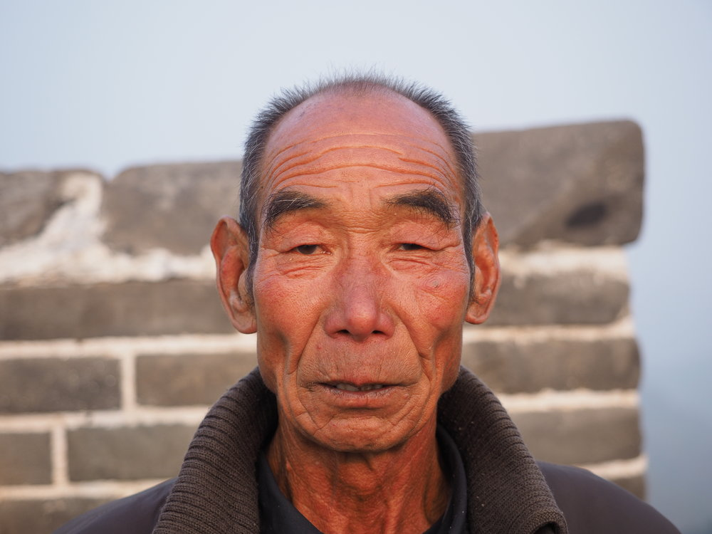 An old man selling drinks on the Great Wall. I had an iced coffee.