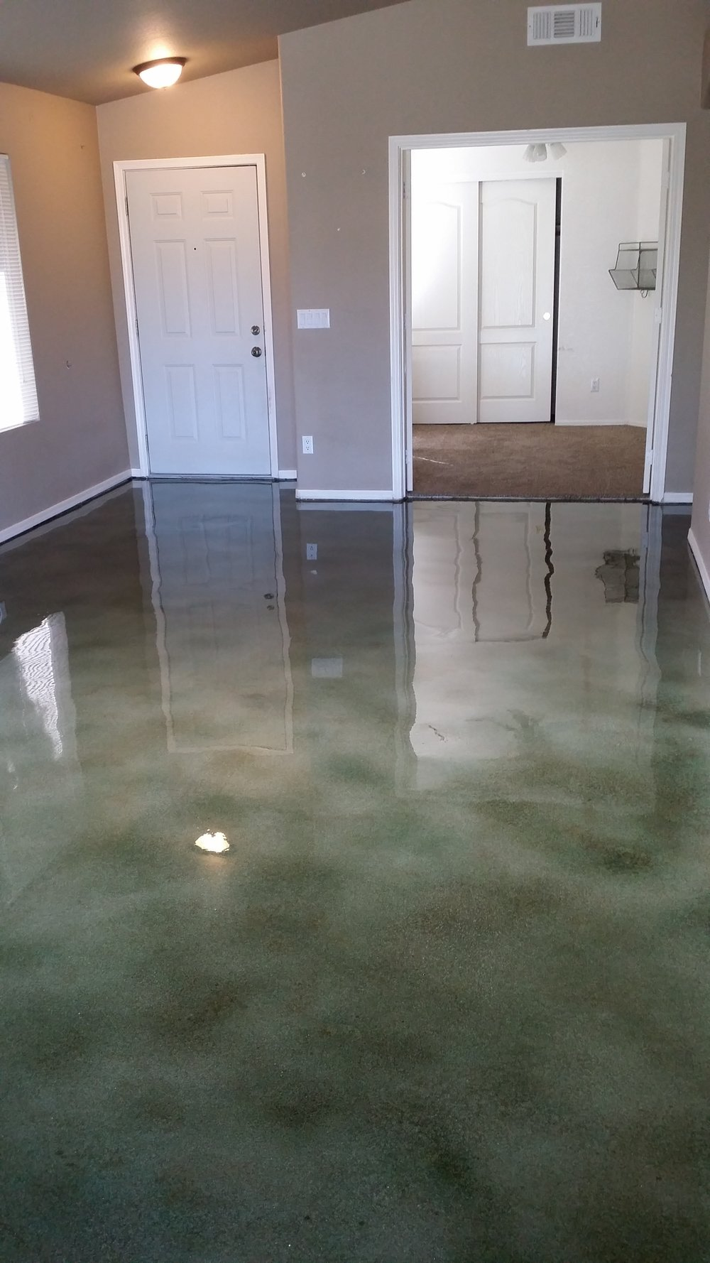 forrest green earth stain over raw concrete