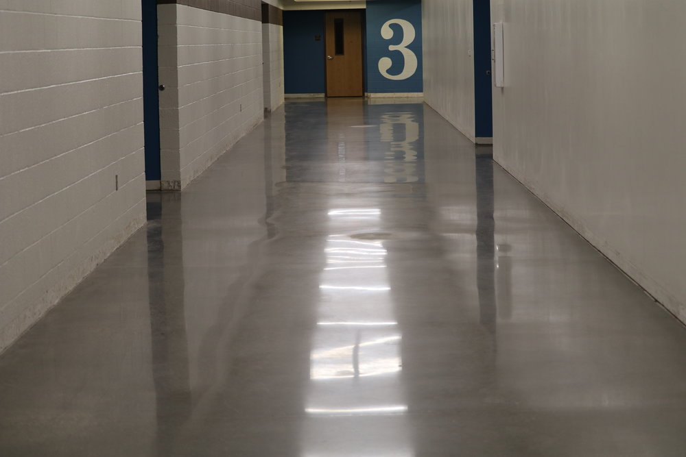Polished Concrete - The most cost-effective way to dress-up large spaces is to polish the existing slab. Through a series of grinding, polishing and chemical treatments, we are able to transform a boring concrete slab into a brilliant piece of floor.
