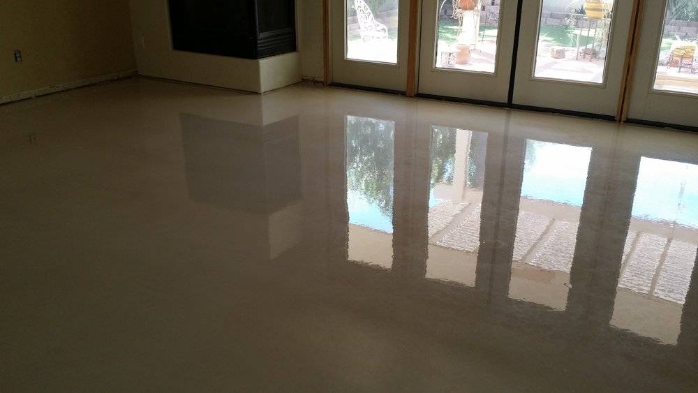 Metallic Epoxy - The beauty of metallic epoxy floors begin with their design versatility- they can be made into contemporary floors or they can be extremely edgy and different. The picture shown is one with pearl pigments. See our gallery for examples of many more types of metallic epoxy designs available.