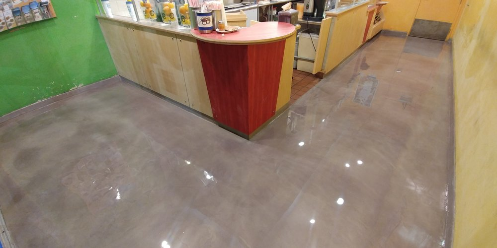 Juice kitchen with a gorgeous overlaid natural concrete gray stain