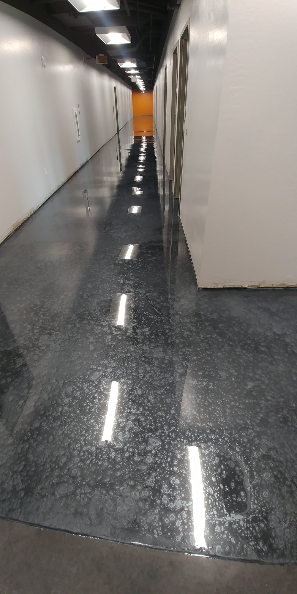 metallic epoxy with cratered effect in a school. a high traffic top coat was applied and still looks pristine one year later!