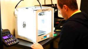 Fab@CIC Grand Opening attendee 3D prints on an Ultimaker.