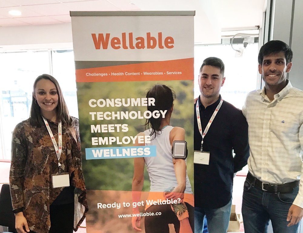 Members of the Wellable team, including Ashley Hopkins, Director of Wellness Program Success at Wellable, Inc. left, Nick Patel, President at Wellable, Inc., right. Photo courtesy of Hopkins.