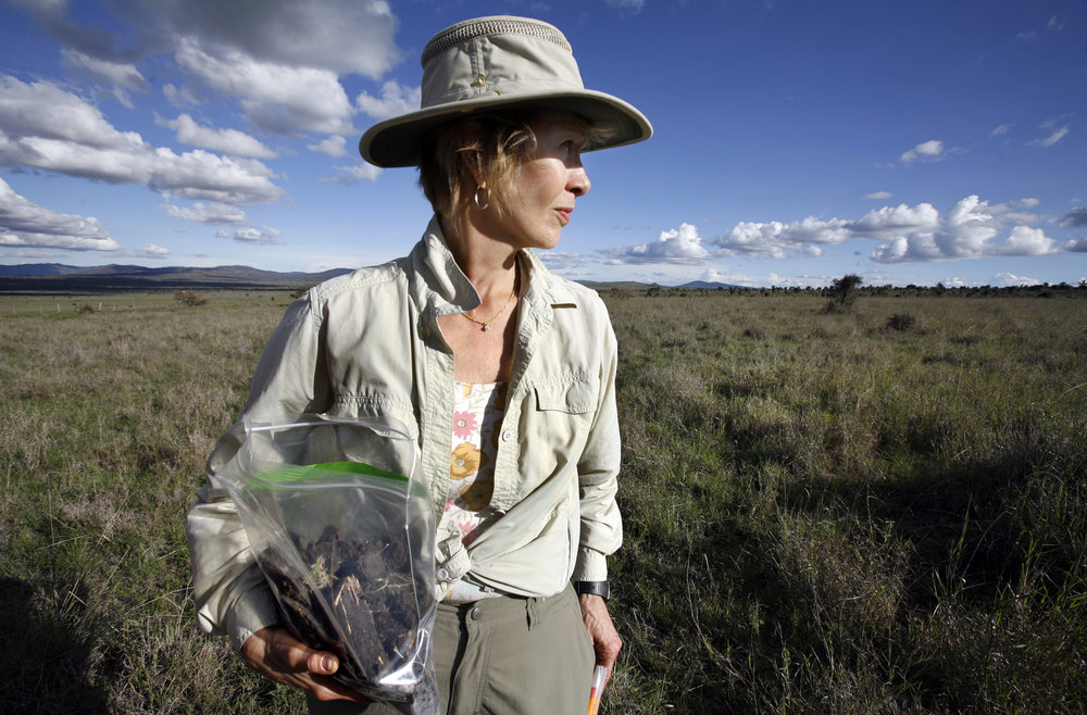 Dr. Diana H. Wall, from the Natural Resource Ecology lab at Colorado State University, holds a bag of soil samples that were collected for her research on below ground animal diversity at Kapiti Plains near Machakos, Kenya.