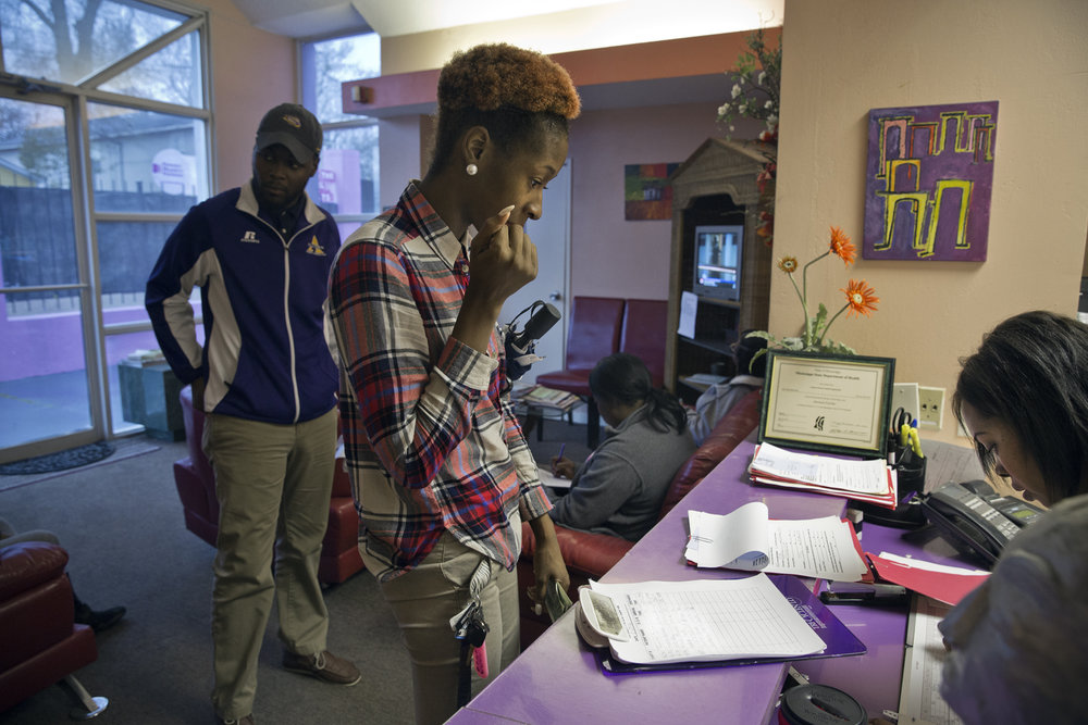 Mikissa pays for her abortion while her boyfriend Terrance Smith, 24, a high-school history teacher, looks on.