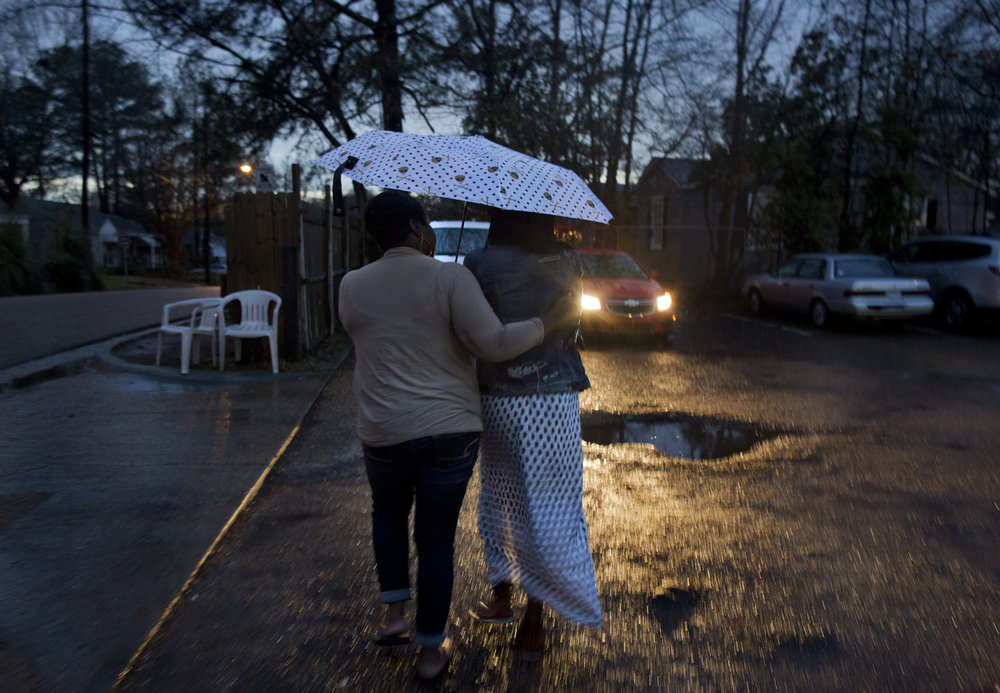 """T"", 20, walks with her mother back to their car, after her abortion. T, who has a son, aged 1, and works at a call center making $9.25/hour part-time, decided she wasn't ready to have another child. She lives in Hattiesburg, an almost two hour drive to Jackson, and her boyfriend, the father of her child, is awaiting trial for his alleged role as a passenger in drive-by shooting."