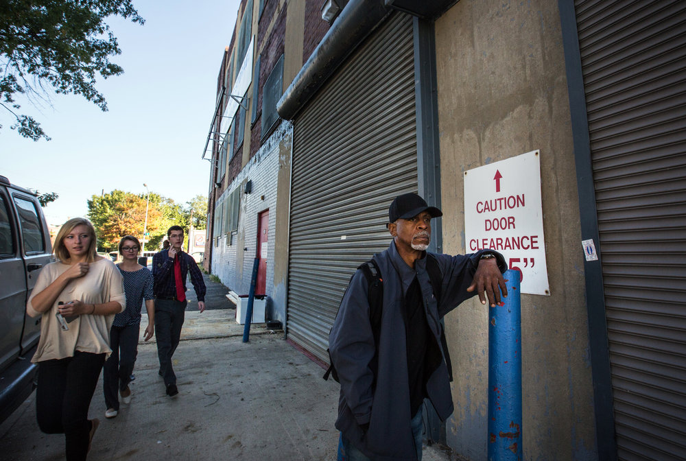 Leon Savoy, waits for Capital Self-Storage to open, so he can get in his unit and change his clothes before heading to his job as a furniture restorer. Savoy is currently homeless and living at a nearby shelter.