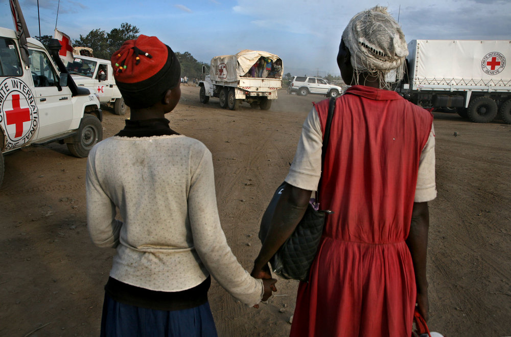 A Luo mother and daughter wait their turn to be evacuated to safety by the Kenyan Red Cross after two days of brutal ethnic violence in Nakuru.