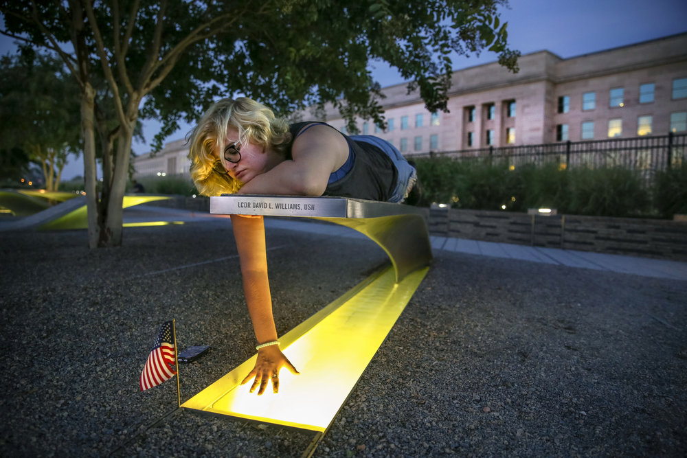 Lexi Palmer, 15, from Springfield, Virginia, reflects during a visit to the Pentagon Memorial, with her family, just days before the 15th anniversary of the September 11th attacks. The Pentagon memorial honors the 184 people who died as victims in the building and on American Airlines Flight 77.