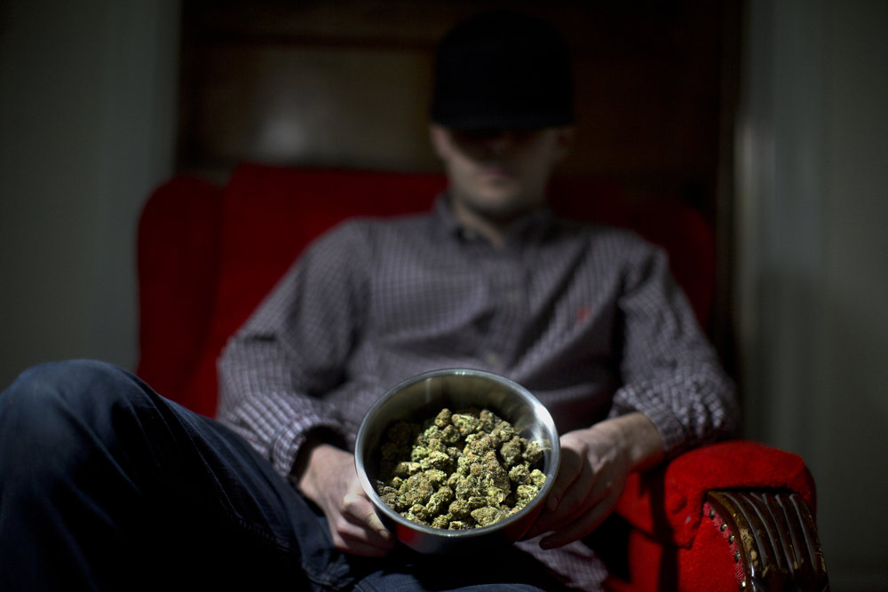 A drug dealer displays the marijuana he sells in his living room in Washington, DC.
