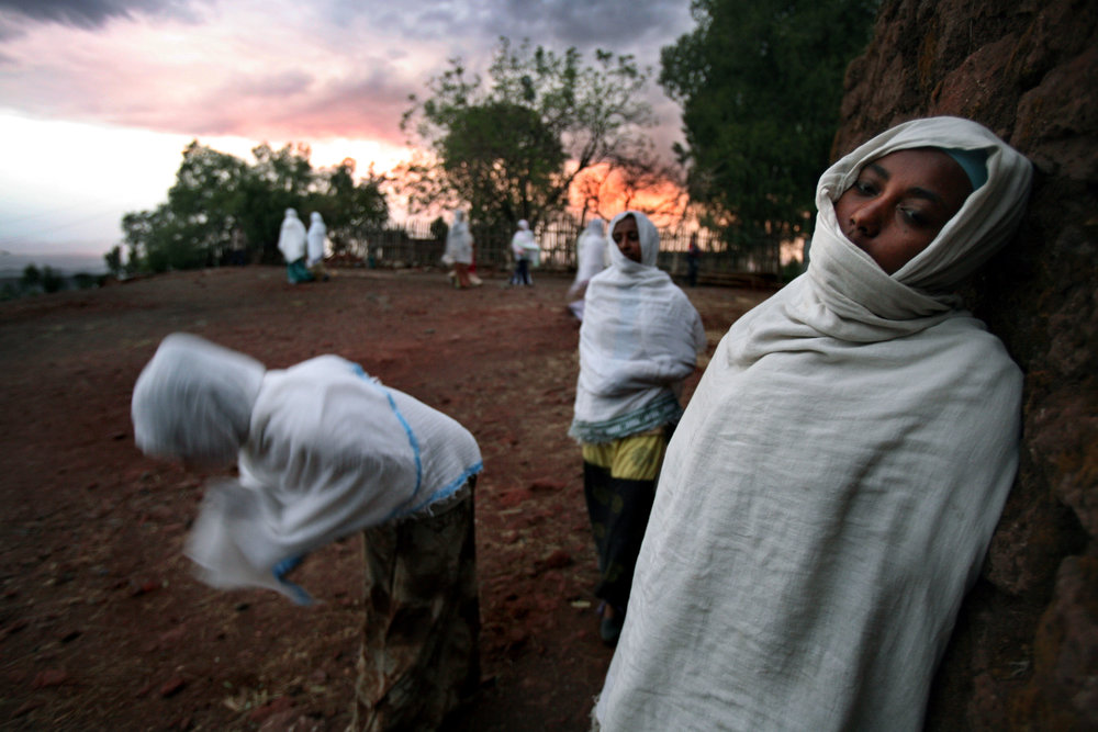 Ethiopians pray on the grounds of the church complex Bet Medhane Alem in Lalibela, Ethiopia.