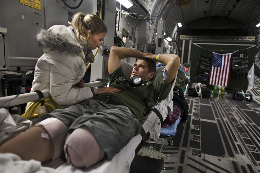 Laura Borneman, with her fiancee Marine 1st Lieutenant Patrick Glavey, aboard the C-17 Globemaster III. Glavey lost both legs and an index finger after stepping on a IED in Afghanistan. The air evacuation team, provide transport planes to carry injured soldiers from Afghanistan to Germany, and then onto the US. Sometimes the aircraft fly directly from Afghanistan to the US with air-to-air refueling.