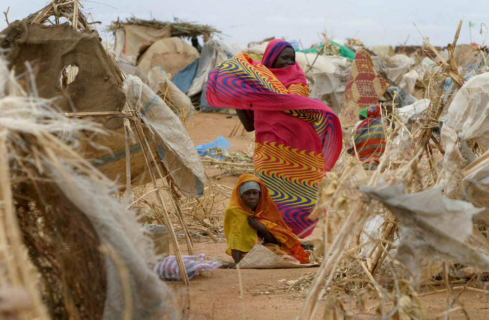 Refugees in Otash camp, South Darfur, have little more than twigs and trash to shelter themselves.