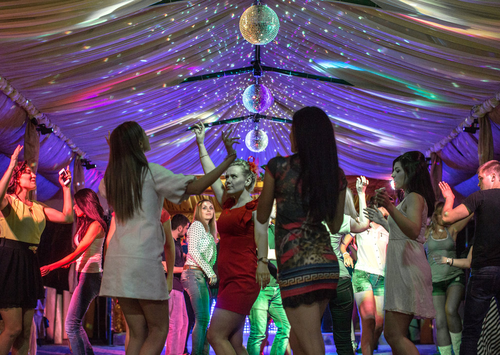 Young Ukrainians dance at the nightclub, House of Meteorologists, in Donetsk, Ukraine, prior to the upcoming presidential election.