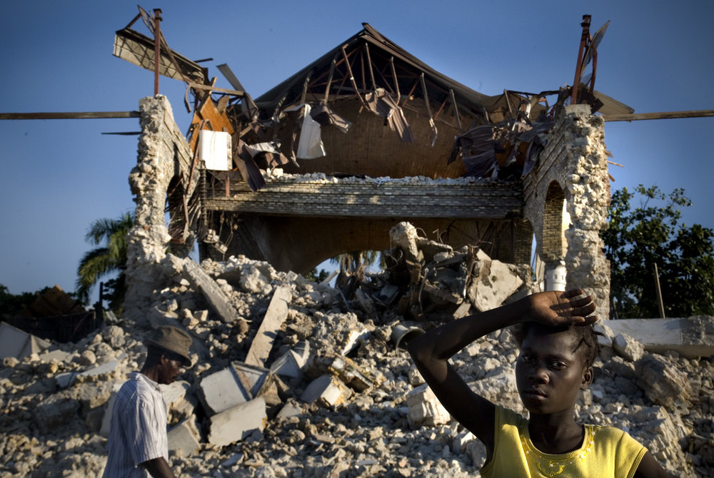 A young girl outside the shell of the largest church in the town of Leogane. About 90% of the city was destroyed in the massive earthquake that rocked Haiti.
