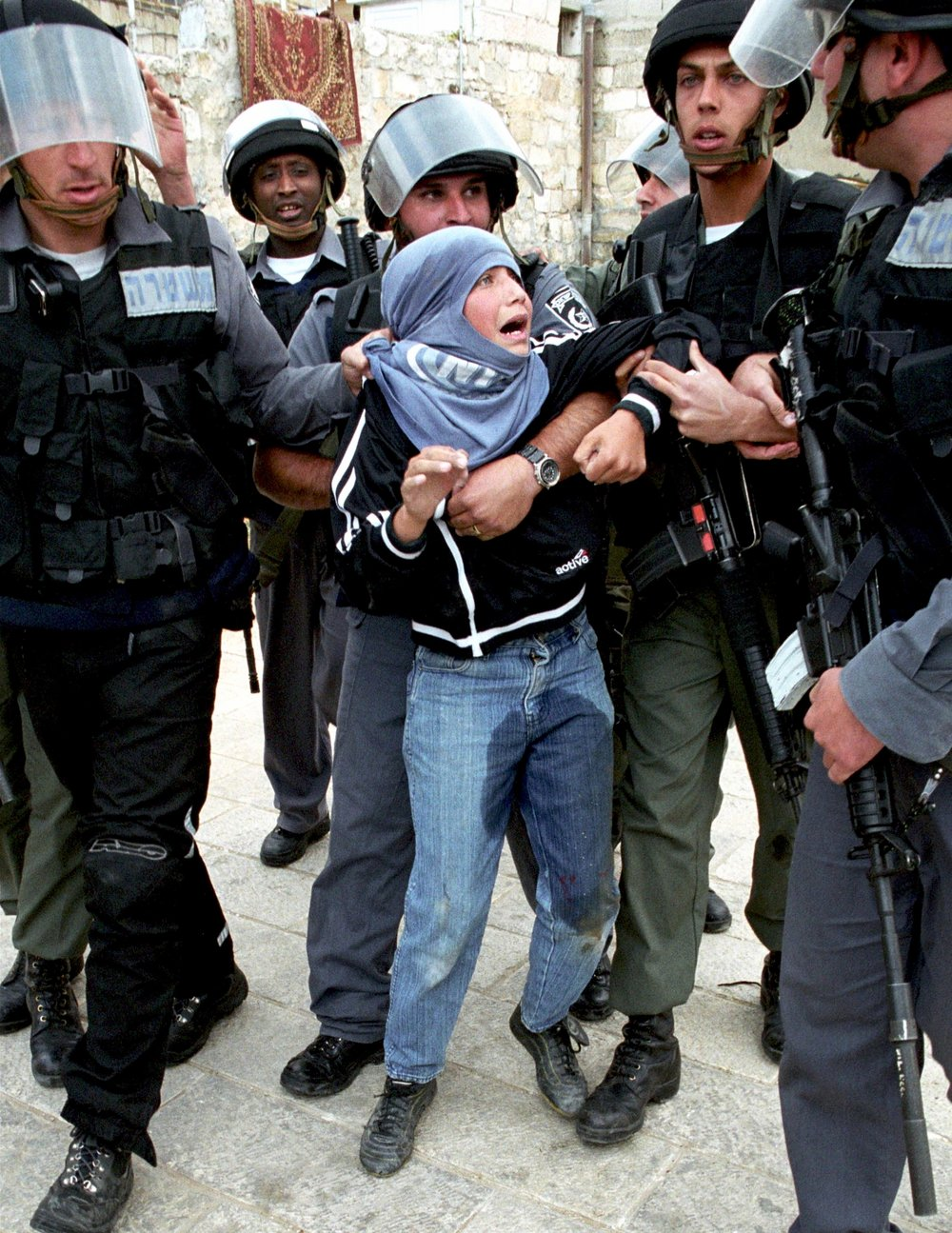 A Palestinian boy wets his pants as he is arrested by Israeli police for throwing stones during clashes with Israeli forces following Friday Muslim prayers in east Jerusalem.