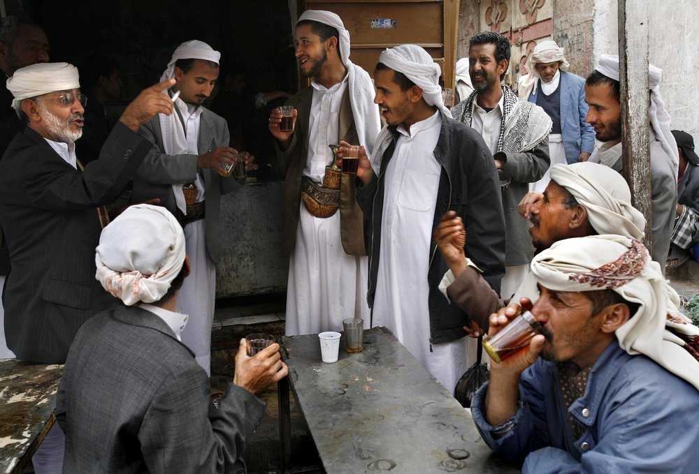 Men drink tea and chat in the Central Souq in San'aa, Yemen.