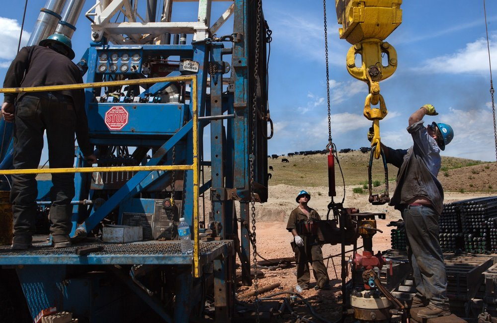 Roughnecks install a secondary rig near Trenton, North Dakota. The oil boom is redrawing North Dakota's landscape and creating opportunity for thousands of unemployed Americans. However, the economic prosperity has exacerbated problems in housing, infrastructure and traffic. North Dakota has long been the least populated state in the country but because of the Bakken oil boom, everyday, mostly men, pour in from across the nation looking for work.