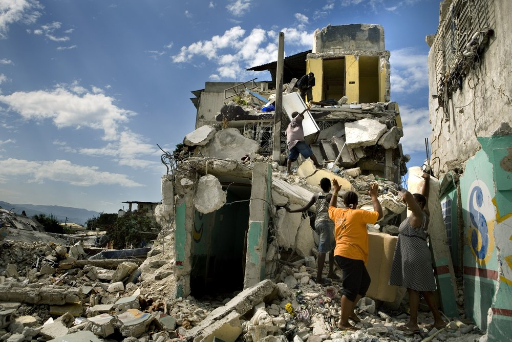 People try to salvage their belongings from the ruin of their homes in downtown Port-Au-Prince.