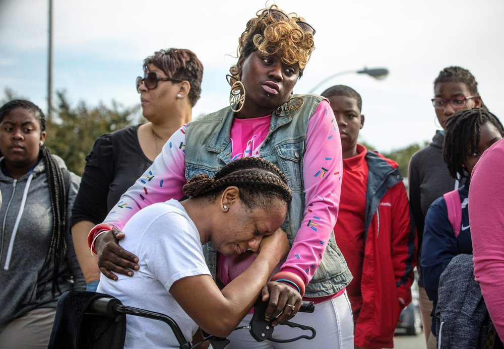 Lakisha Jenkins, the mother of Keyshaun Mason,14, grieves outside Potomac High School in Oxon Hill, MD. During a domestic dispute, Lakisha Jenkins, was barricaded in the master bedroom of her home by her live-in boyfriend, 48-year-old Sean Crawford. Crawford was armed with a kitchen knife. Keyshaun Mason, 14, and his 18-year-old brother attempted to enter the master bedroom to ask Crawford to leave their home. According to the documents, Crawford then stabbed Keyshaun in the chest. Both teens were taken to a local hospital where Keyshaun was pronounced dead.