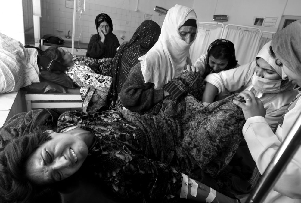A woman in labor about to give birth is tended to by a midwife at the crowded maternity ward at the only city hospital in Herat, Afghanistan. Afghan women suffer from one of the highest levels of maternal mortality in the world, with almost half of all deaths among women aged 15 to 49 coming as a result of pregnancy and childbirth. Religious tradition and the Taliban regime left a severe shortage of doctors, especially female doctors in Afghanistan. In many parts of the country, especially in the south, social customs dictate that women cannot leave their homes without being accompanied by male family members, and pregnant women cannot be treated by male doctors. Many women turn to midwives with little, if any, training. Women have been systematically denied access to health services by society and their families.