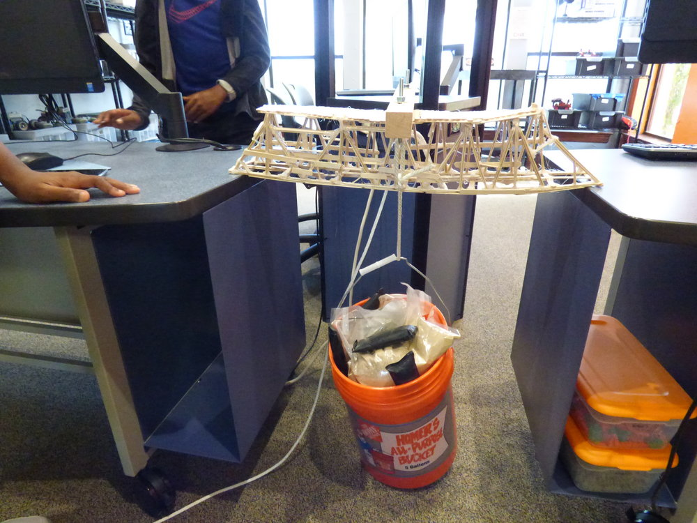 Testing a popscicle bridge with 50 lbs.JPG