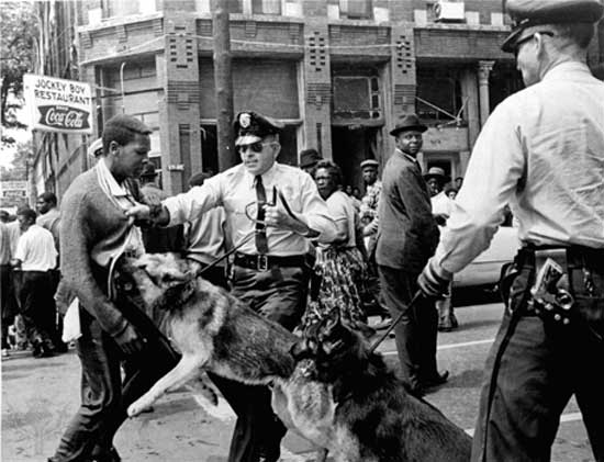 Source: AP; May 3, 1963 in Birmingham, AL, police officers attacking unarmed Civil Rights activists.