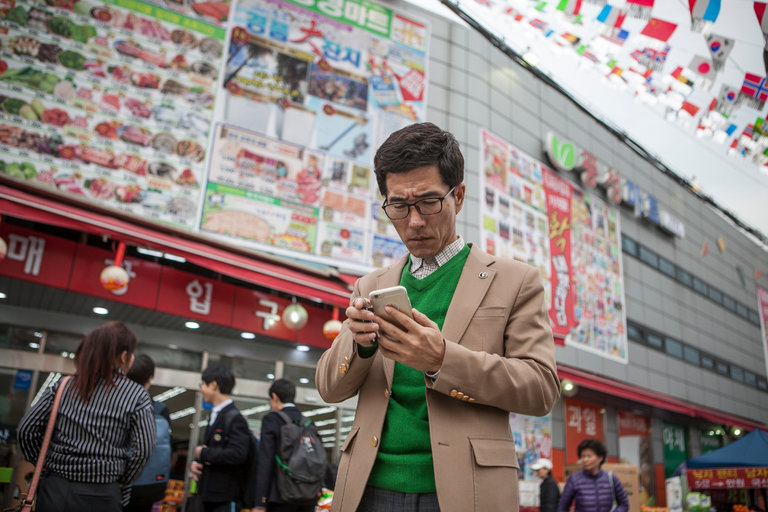 Source: the NY Times; Korean man holding cellphone