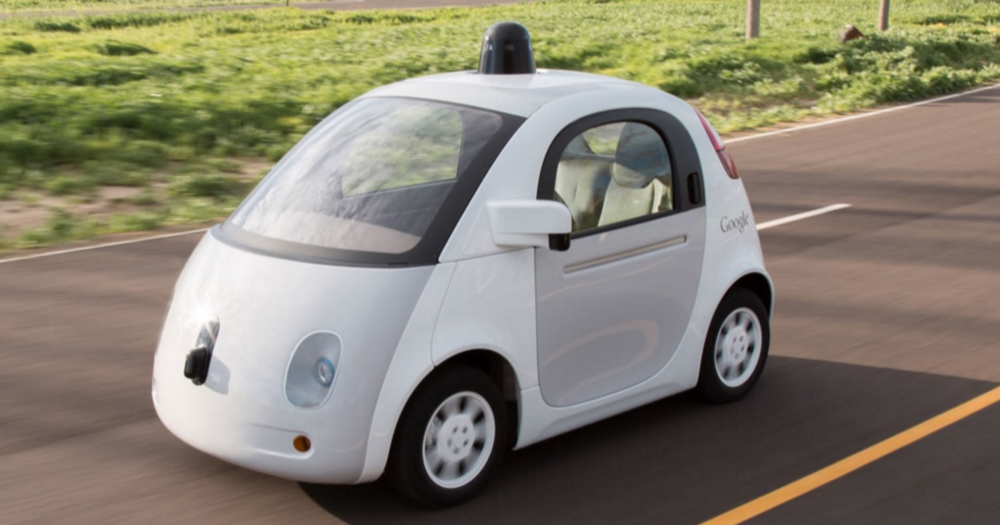 Source: The Inverse; self-driving car on the road.