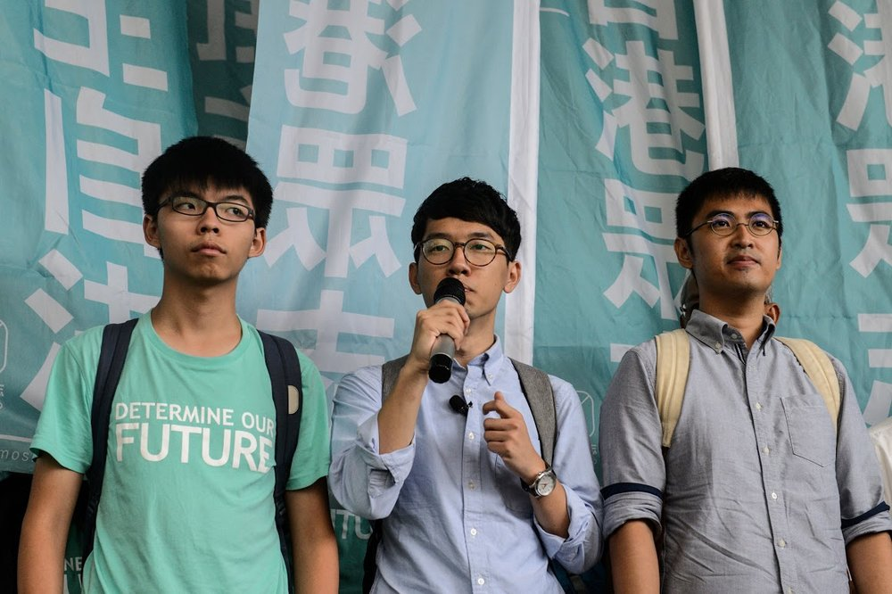 (L to R) Joshua Wong, 19, Nathan Law, 23, and Alex Chow, 25. (  Photo:   Anthony Wallace/AFP/Getty Images  )